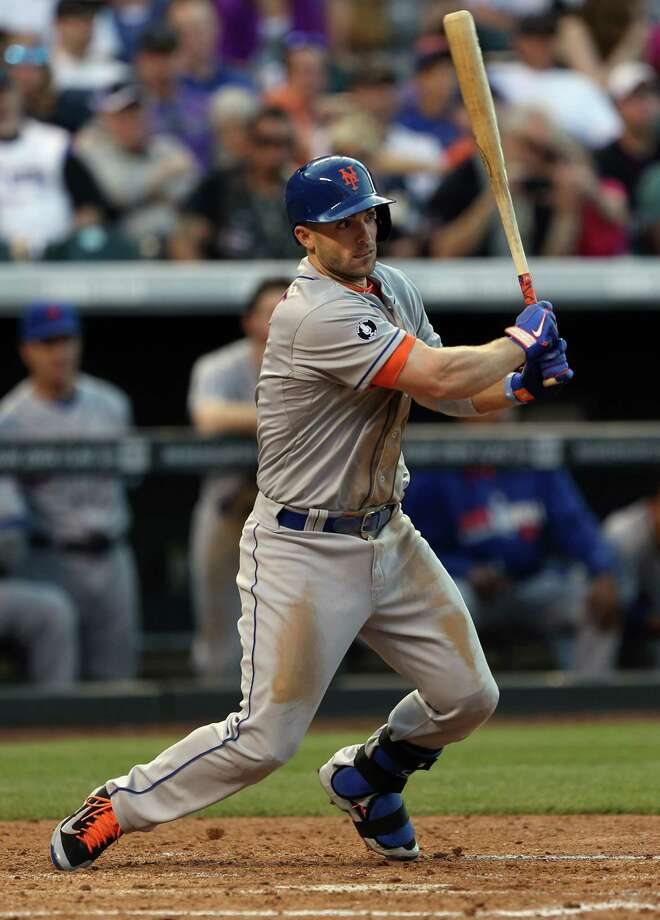 New York Mets' David Wright singles against the Colorado Rockies in the fourth inning of a baseball game in Denver, Saturday, May 3, 2014. (AP Photo/David Zalubowski) ORG XMIT: CODZ111 Photo: David Zalubowski / AP