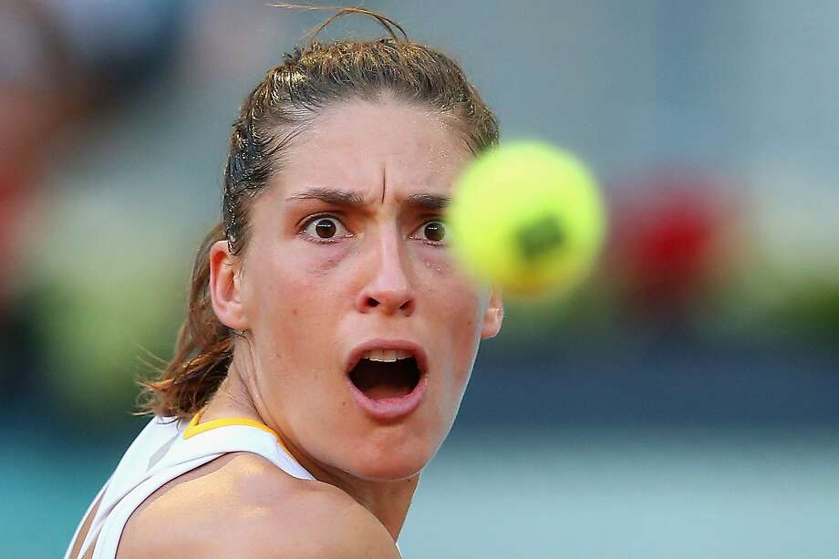MADRID, SPAIN - MAY 03:  Andrea Petkovic of Germany in action against Sara Errani of Italy during day one of the Mutua Madrid Open tennis tournament at the Caja Magica on May 3, 2014 in Madrid, Spain.  (Photo by Julian Finney/Getty Images) *** BESTPIX *** Photo: Julian Finney, Getty Images