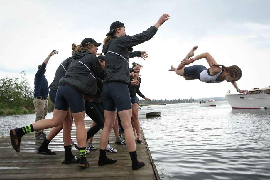 UW Coxswain Marlow Mizer is tossed into the water. Photo: JOSHUA TRUJILLO, SEATTLEPI.COM / SEATTLEPI.COM
