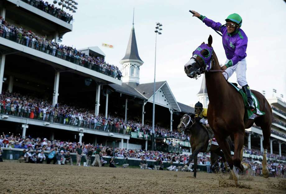 Victor Espinoza rides California Chrome to victory during the 140th running of the Kentucky Derby horse race at Churchill Downs Saturday, May 3, 2014, in Louisville, Ky.(AP Photo/David J. Phillip) Photo: David J. Phillip / Associated Press / AP