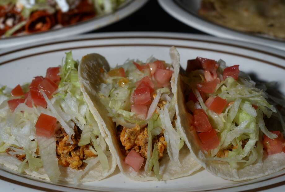 Pork taco at the Taco Place in Beaumont. The dish is also available with beef, chicken and several other flavors of pork. Photo taken Monday, April 21, 2014 Guiseppe Barranco/@spotnewsshooter