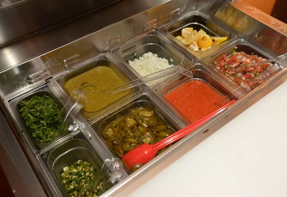 Salsa and flavoring bar at the Taco Place in Beaumont. Photo taken Monday, April 21, 2014 Guiseppe Barranco/@spotnewsshooter