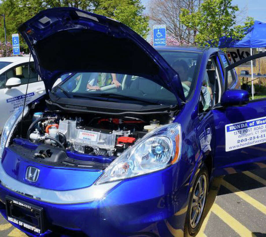 This electric Honda Fit was one of the vehicles at last year's EV Road Rally sponsored by the Westport Electric Car Club. This year's event starts at 9 a.m. today at the Saugatuck train station's eastbound depot. Photo: File Photo / Westport News