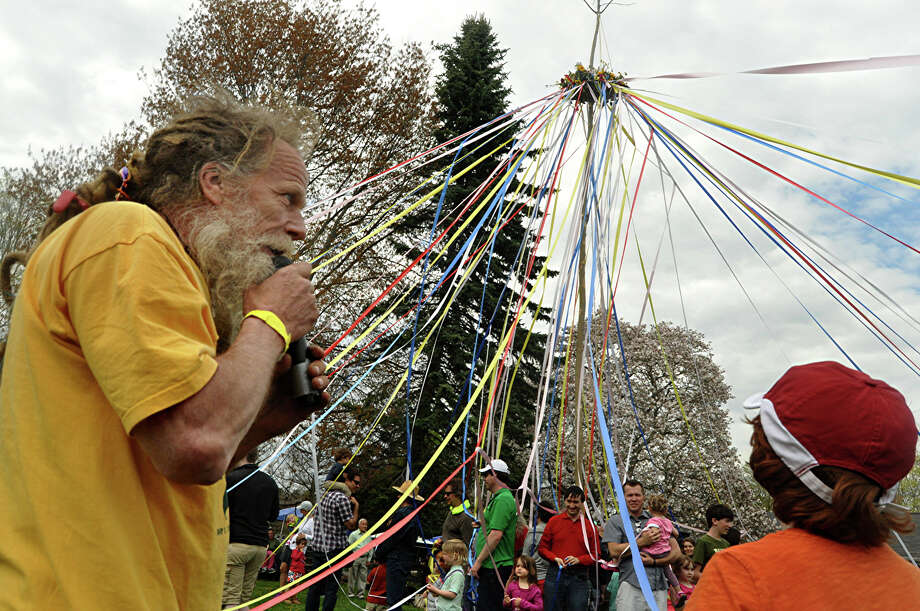 Bill Fischer leads Maypole festivities Saturday at Wakeman Town Farm. Photo: Nancy Guenther Chapman / Westport News