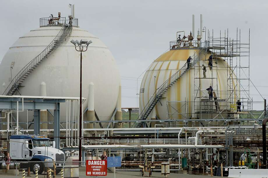 Employees work on a storage tank inside the Chevron Corp. Richmond Refinery stands in Richmond, California, U.S., on Thursday, April 24, 2014. Chevron Corp. hopes to gain city approval to finish hydrogen plant at the Richmond refinery in June or July. Photographer: David Paul Morris/Bloomberg Photo: David Paul Morris, Bloomberg