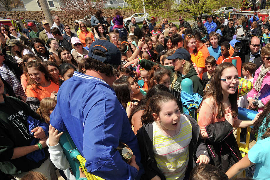Children crowd through through the playground entrance immediately after the ribbon cutting during the Sandy Ground Project: Where Angels Play dedication ceremony to honor Sandy Hook Elementary School shooting victim Jesse Lewis at West Beach in Stamford, Conn., on Sunday, May 4, 2014. Photo: Jason Rearick / Stamford Advocate