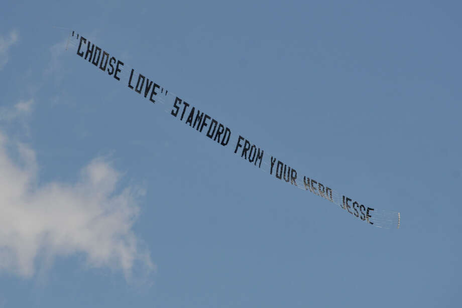 "An airplane pulls a sign saying: '""Choose Love"" Stamford from your hero Jesse' during the Sandy Ground Project: Where Angels Play playground dedication ceremony to honor Sandy Hook Elementary School shooting victim Jesse Lewis at West Beach in Stamford, Conn., on Sunday, May 4, 2014. Photo: Jason Rearick / Stamford Advocate"