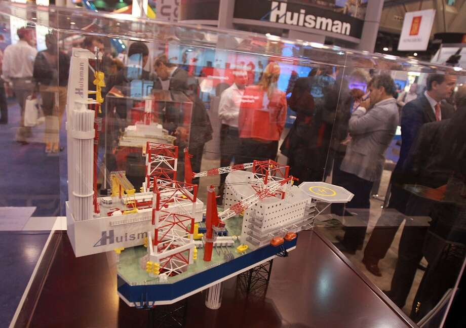 2013 -- Attendance rises above 100,000 for the first time since 1982.  Attendance: 104,800  Space: 652,185 sf  Exhibiting companies: 2,728  [Photo: A Huisman oil platform is on display during the Offshore Technology Conference.] Photo: Mayra Beltran