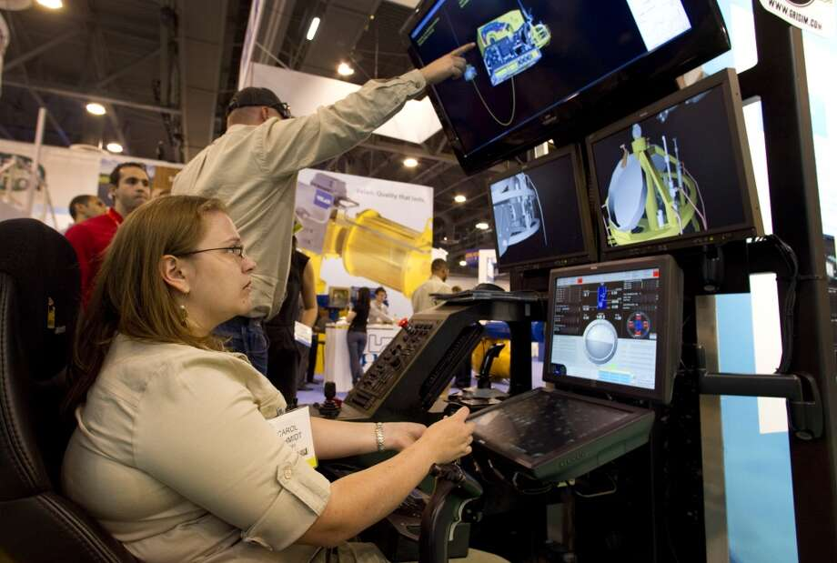 2012 -- Attendance reaches the highest level in 30 years.  Attendance: 89,400  Space: 641,350 sf  Exhibiting companies: 2,538  [Photo: Carol Schmidt runs an ROV simulator at the Saipem booth during the 2012 Offshore Technology Conference.] Photo: Brett Coomer, Houston Chronicle