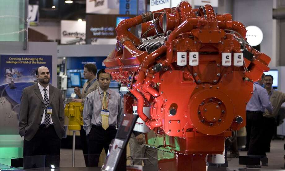 2010Attendance: 72,900  Space: 568,190 sf  Exhibiting companies: 2,532  [Photo: David Lerch (left) and Mike Wu (2nd from left) look over a Cummins diesel engine during the Offshore Technology Conference.] Photo: James Nielsen, Houston Chronicle