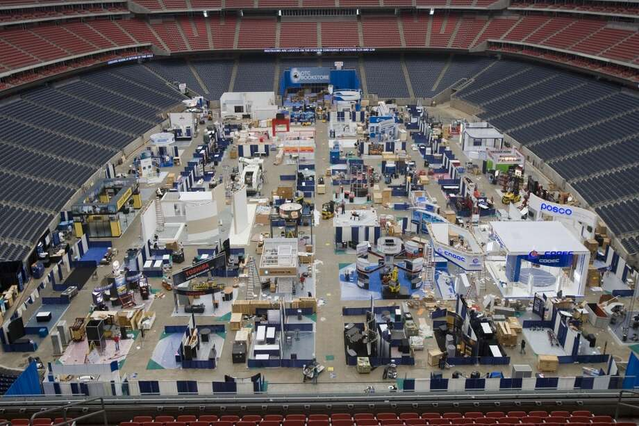 2009Attendance: 67,721  Space: 556,909 sf  Exhibiting companies: 2,535  [Photo: Workers complete display booths during the set up for the Offshore Technology Conference.] Photo: James Nielsen, Houston Chronicle