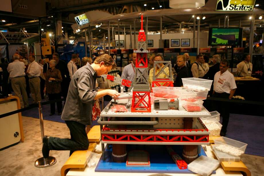 2008Attendance: 73,318  Space: 556,640 sf  Exhibiting companies: 2,357  [Photo: Brick Artist Nathan Sawaya builds a scale replica of a drilling rig at the Weatherford booth at the Offshore Technology Conference. Sawaya is a New York based artist and uses Lego building blocks. ] Photo: Steve Campbell, Houston Chronicle