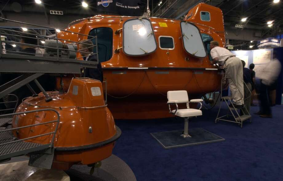 2004 -- OTC launches the Spotlight on New Technology program to recognize advancements in ocean resources development.  Attendance: 50,921  Space: 397,750 sf  Exhibiting companies: 2,127  [Photo: The escape and rescue craft made by Survival Systems International, noted for its single point connection, was among the displays at the Offshore Technology Conference.] Photo: Steve Ueckert, Houston Chronicle