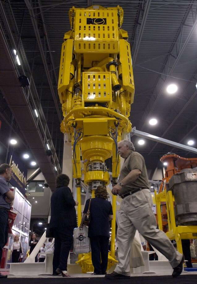 2003  Attendance: 50,655  Space: 384,450 sf  Exhibiting companies: 2,010  [Photo: People walk by National Oilwell Varco's PS2-750A  Top Drive drilling system during the Offshore Technology Conference at Reliant Center.] Photo: Christobal Perez, Houston Chronicle