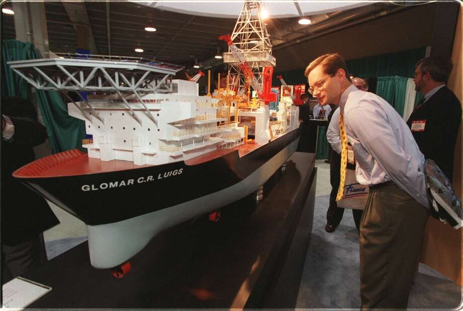 1999  Attendance: 44,749  Space: 376,639 sf  Exhibiting companies: 1,900  [Photo: Douglas Priedeman of Exxon looks at a Glomer C.R. Luigs ship model. The ship is capable of drilling 12,000 feet while at sea.] Photo: Ben Desoto, Houston Chronicle