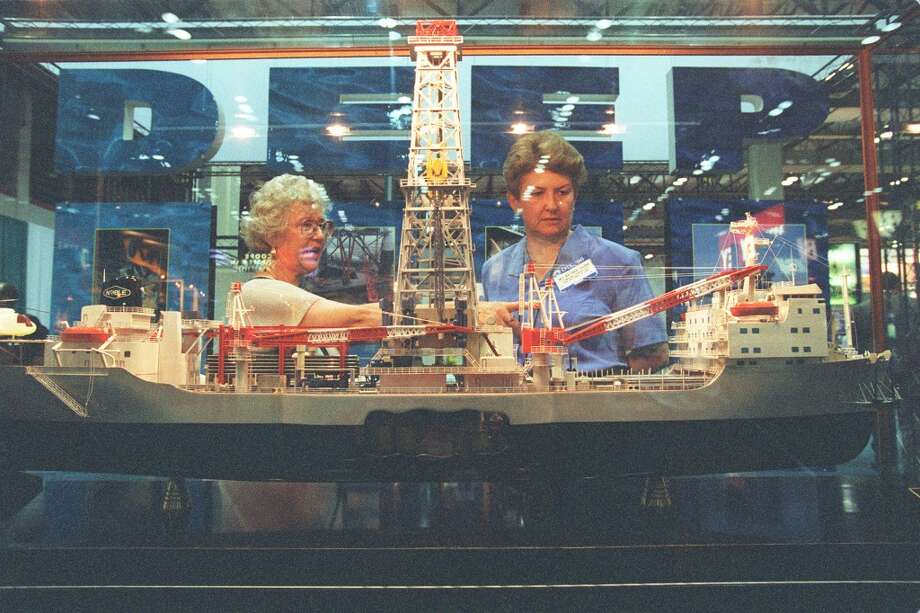 1998Attendance: 49,641  Space: 370,166 sf  Exhibiting companies: 1,846  [Photo: OTC attendees (from left) Therese Pumford and Mary Barber examine a model of a Noble Drilling deep-sea drill ship at the Offshore Technology Conference. The mammoth event occupied at the Astroarena and Astrohall.] Photo: Carlos Antonio Rios, Houston Chronicle