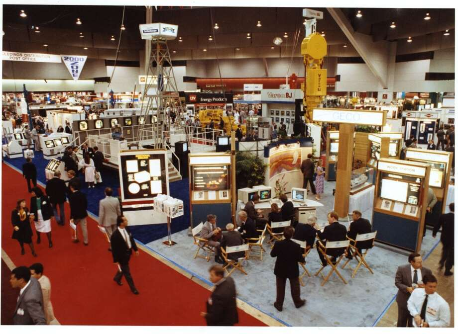1990Attendance: 31,451  Space: 210,000 sf  Exhibiting companies: 1,240  [Photo: Oil service and supply companies display the latest technologies and engineers discuss the newest concepts for use in the offshore environment on the exhibit floor of the 1990 Offshore Technology Conference.] Photo: Buster Dean, Houston Chronicle
