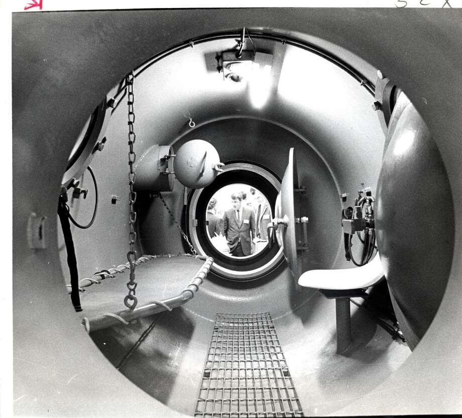1969 -- First Offshore Technology Conference  Attendance: 4,200  Space: 38,500 square feet  Exhibiting companies: 200  [Photo: An OTC attendee stands outside a decompression chamber by Wilson Industries. The first conference was held at the Convention and Exhibit Center in downtown Houston.] Photo: Tom Colburn, Houston Chronicle