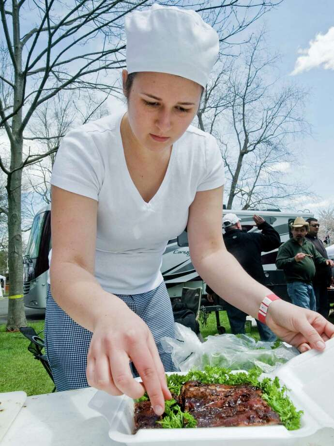 Kelley Drukker of Ridgefield touches up the garnish on a rib dish for the BBQ competition at the Ridgefield Gone Country Barbecue Festival held at the Ridgefield Community Center. Sunday, May 4, 2014 Photo: Scott Mullin / The News-Times Freelance