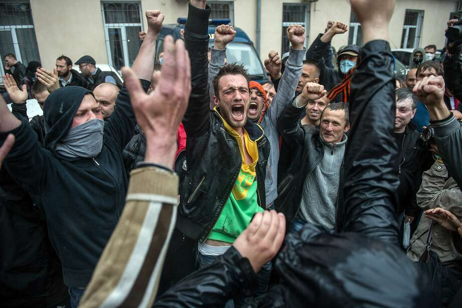 Pro-Russian militants celebrate in Odessa after activists attacked a police station and they were freed. Photo: Dmitry Serebryakov, AFP/Getty Images