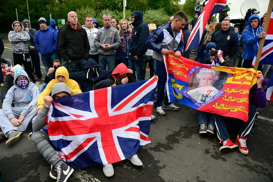 Loyalists gather in Antrim, Northern Ireland, after news of Sinn Fein leader Gerry Adams' release. Photo: Jeff J Mitchell, Getty Images