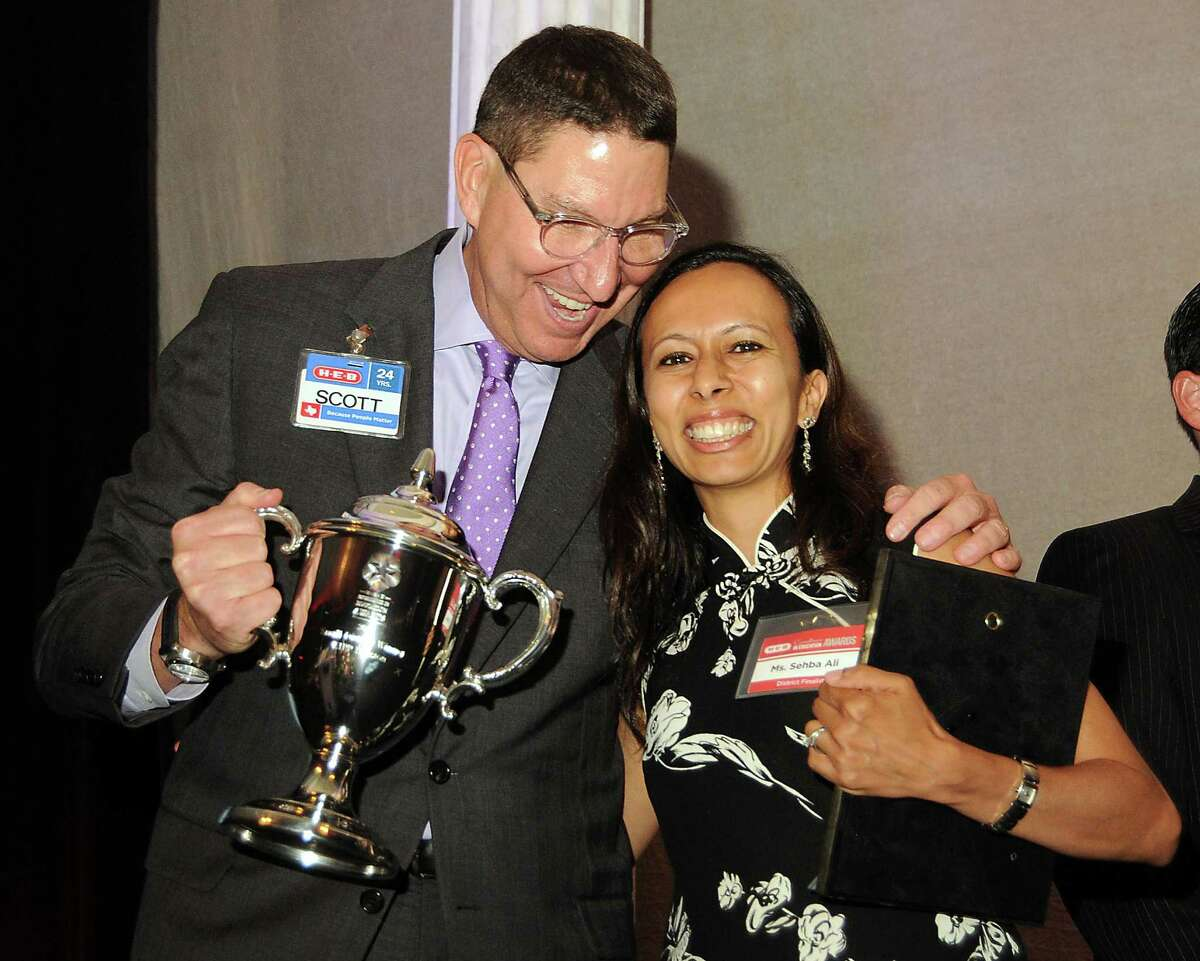 HEB President Scott McClelland hugs KIPP Superintendent Sehba Ali after the charter school network won a $50,000 prize at the HEB Excellence in Education Awards dinner in May 2014. KIPP had four campuses highlighted for having a small or non-existent achievement gapin a March 2016 report by Education Cities.