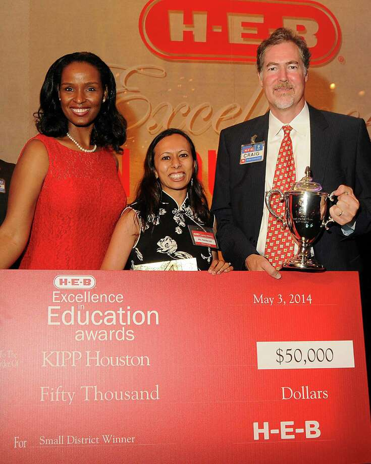 Sehba Ali,center, superintendent for KIPP Houston, poses with a $50,000 prize the school received at the HEB Excellence in Education Awards dinner at the Royal Sonesta Hotel Saturday May 03, 2014. Also pictured are HEB's Winell Herron, at left, and HEB's Craig Boyan. (Dave Rossman photo) Photo: Dave Rossman, For The Houston Chronicle / © 2014 Dave Rossman