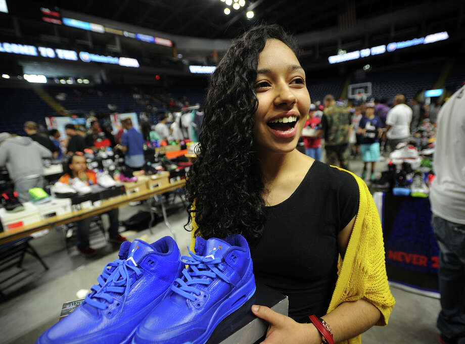 Emily Cortes, of Bridgeport, looks to sell a pair of customized sneakers, painted in Smurf blue with dunking Smurf logos, at the inaugural Connecticut Sneaker Show at the Webster Bank Arena in Bridgeport, Conn. on Sunday, May 4, 2014. Photo: Brian A. Pounds / Connecticut Post