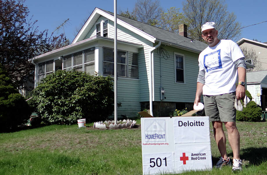 Chris Purcell, a HomeFront board member, at the Lenox Road home he and a team of volunteers helped repair Saturday. Photo: Mike Lauterborn / Fairfield Citizen