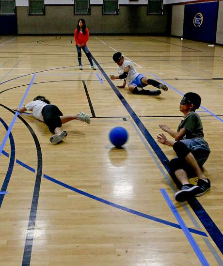 Vana Chalian (left), Danny Vang and Chris Lucero try to stop a scoring attempt during goalball practice at UC Berkeley. Players are sight-impaired or wear blindfolds and listen for the ball, which has bells in it. Photo: Michael Macor, The Chronicle