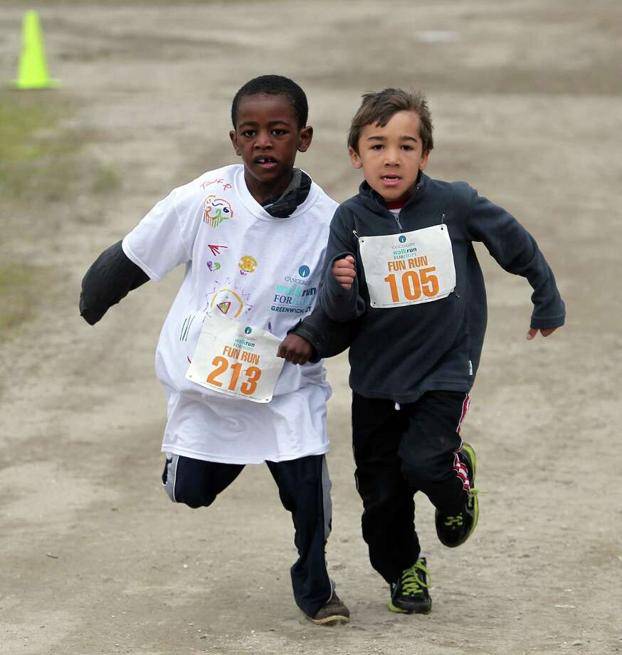 Tafe Burk, 5, and Zafran Kocyba, 6, race each other to the finish line in the children's run for CancerCares, 5K Walk/Run for Hope fundraiser at Tod's Point in Greenwich, Conn. on Sunday, May 4, 2014. Photo: J. Gregory Raymond / Greenwich Time Freelance;  © J. Gregory Raymond