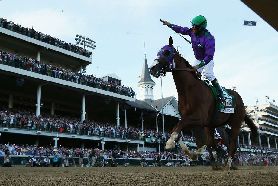 California Chrome and jockey Victor Espinoza have two weeks to prepare for the Preakness. Photo: Matthew Stockman, Getty Images
