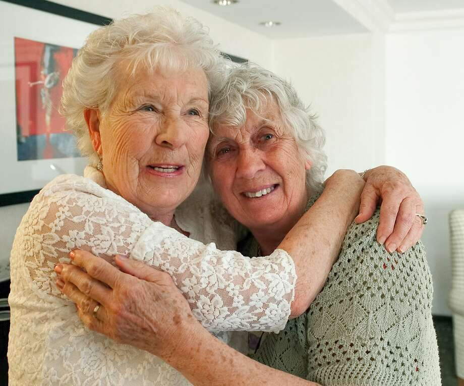 Ann Hunt (left) of England and Liz Hamel of Oregon meet in Fullerton. Hunt was given up for adoption shortly after their birth in 1936. Photo: Leonard Ortiz, Associated Press