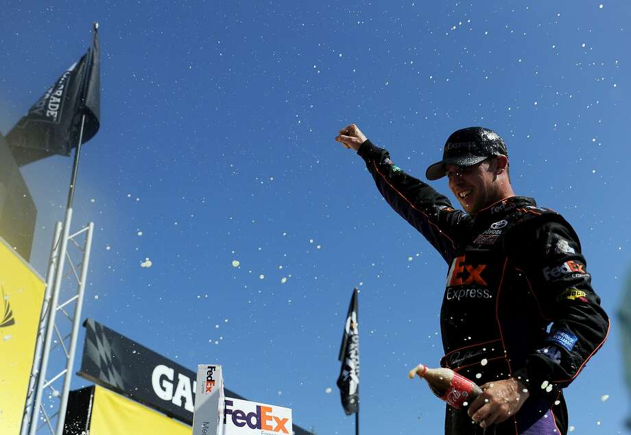 Denny Hamlin became the eighth different winner in 10 Sprint Cup races in 2014. Photo: Patrick Smith, Getty Images