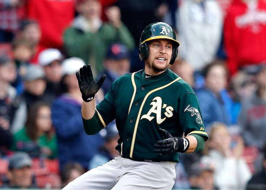 BOSTON, MA - MAY 4:  Jed Lowrie #8 of the Oakland Athletics reacts after scoring the go-ahead run against the Boston Red Sox in the tenth inning at Fenway Park on May 4, 2014 in Boston, Massachusetts.  (Photo by Jim Rogash/Getty Images) Photo: Jim Rogash, Getty Images