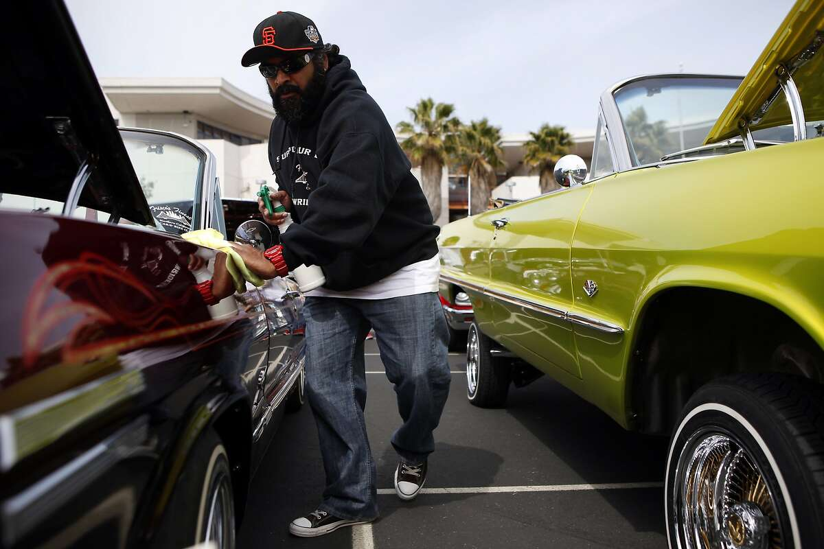 Ron Prasad polishes his 1963 Chevy Impala during a low rider car show benefit fundraiser at John O'Connell High School in San Francisco, CA, Sunday May 4, 2014.