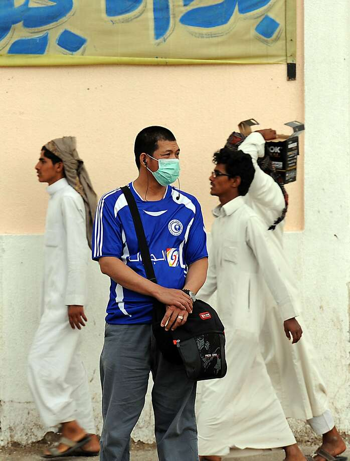 The virus begins with flu-like fever and cough but can lead to shortness of breath, severe pneumonia and death. Photo: Fayez Nureldine, AFP/Getty Images