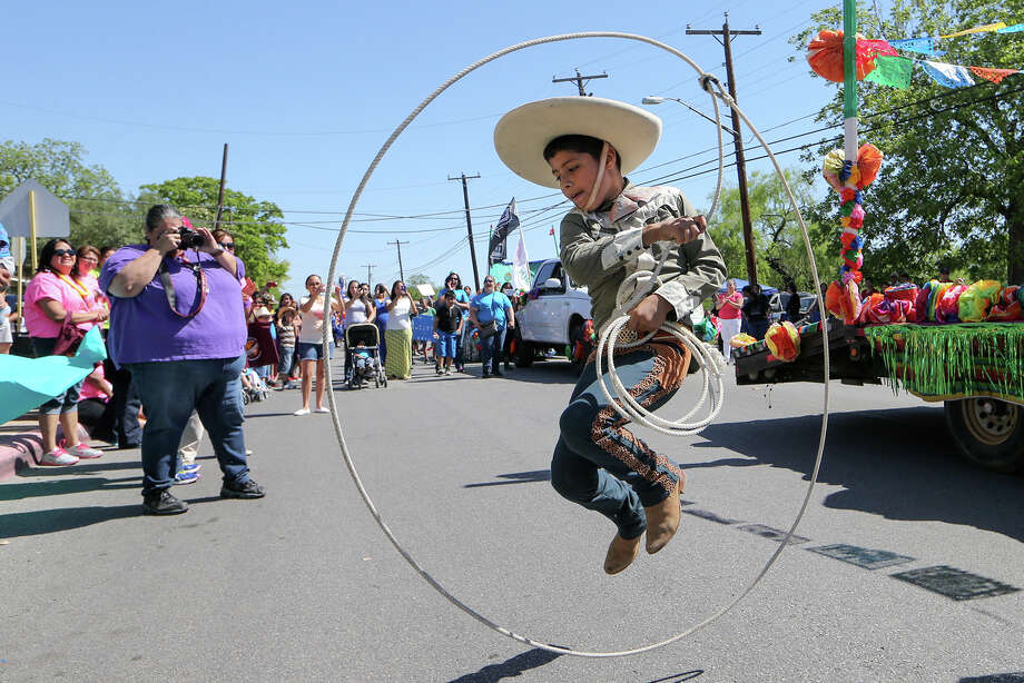 Loma Park Elementary's Salomon Sanchez, 10, jumps through his rope while performing charro rope tricks during Edgewood ISD's Cinco de Mayo parade and festival on SW 34th St. in front of Edgewood Fine Arts Academy on Sunday, May 4, 2014.  All 20 disctict schools participated in the event.  MARVIN PFEIFFER/ mpfeiffer@express-news.net Photo: MARVIN PFEIFFER, Marvin Pfeiffer/ Express-News / Express-News 2014