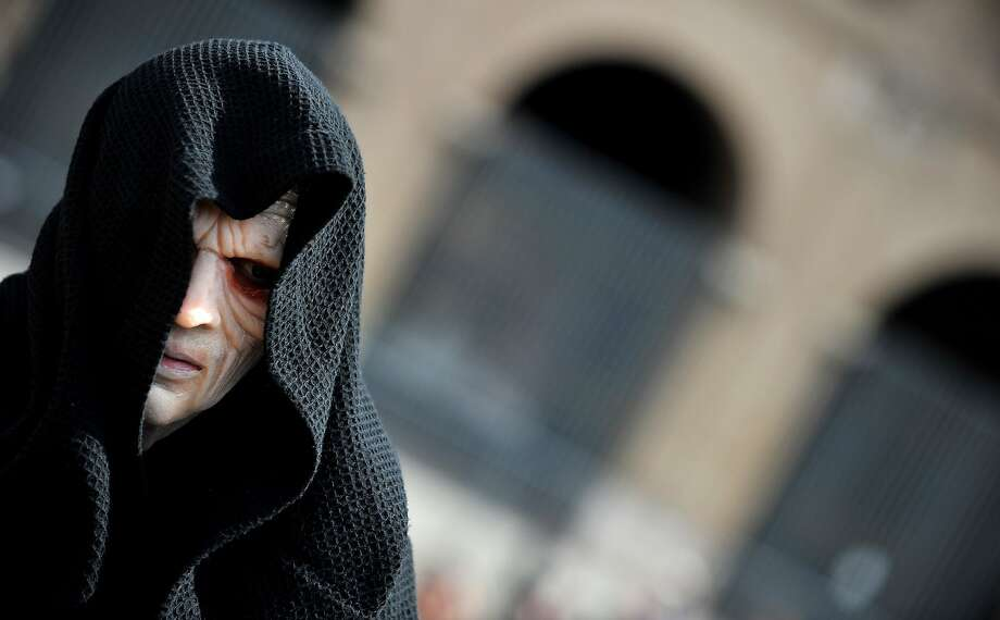 "A member of the Star Wars fan club dressed as Darth Sidious (front) takes part in the ""Star Wars Day"" in front of the Colosseum in central Rome on May 4, 2014. Photo: Tiziana Fabi, AFP/Getty Images"