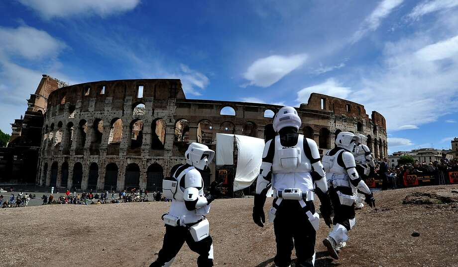 "Members of the Star Wars fan club dressed as stormtroopers celebrate ""Star Wars Day"" in front of the Colosseum in central Rome on May 4, 2014 AFP PHOTO / TIZIANA FABITIZIANA FABI/AFP/Getty Images Photo: Tiziana Fabi, AFP/Getty Images"
