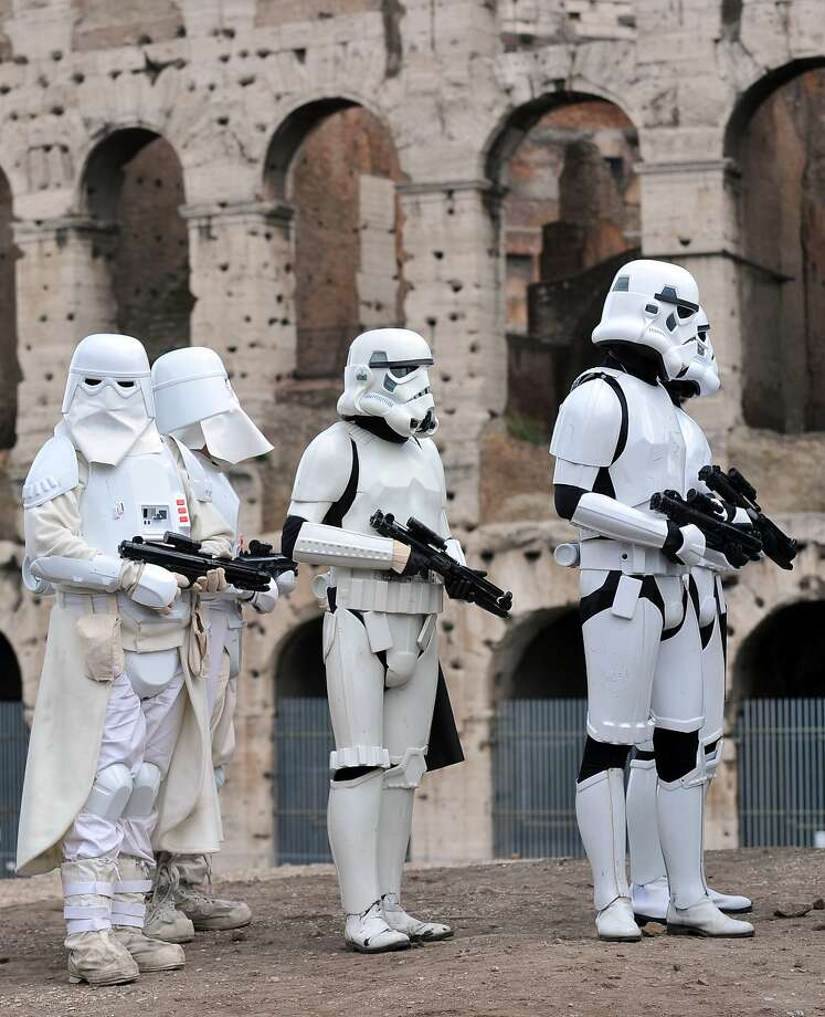 "Members of the Star Wars fan club dressed as Stormtroopers celebrate ""Star Wars Day"" in front of the Colosseum in central Rome on May 4, 2014. Photo: Tiziana Fabi, AFP/Getty Images"