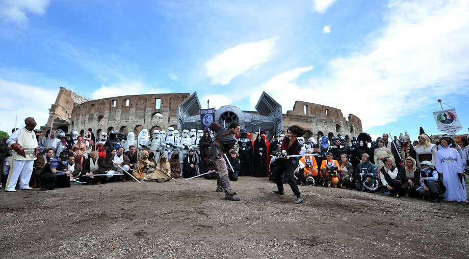"Members of the Star Wars fan club celebrate ""Star Wars Day"" in front of the Colosseum in central Rome on May 4, 2014. Photo: Tiziana Fabi, AFP/Getty Images"