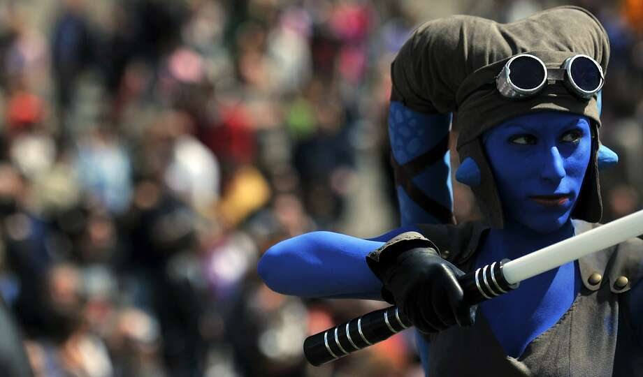 """A member of the Star Wars fan club dressed as Aayla Secura celebrates """"Star Wars Day"""" in front of the Colosseum in central Rome on May 4, 2014. Photo: Tiziana Fabi, AFP/Getty Images"""