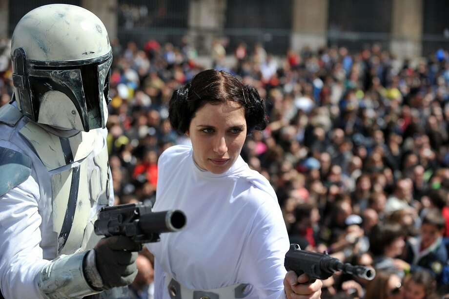 "A member of the Star Wars fan club dressed as Princess Leia celebrates ""Star Wars Day"" in front of the Colosseum in central Rome on May 4, 2014. Photo: Tiziana Fabi, AFP/Getty Images"