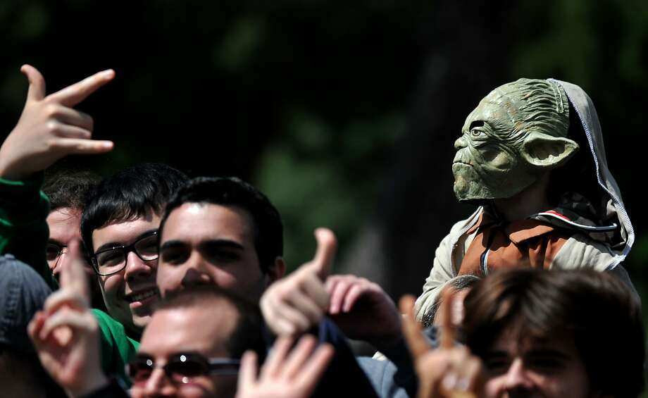 "A man dressed as Master Yoda takes part in the ""Star Wars Day"" in front of the Colosseum in central Rome on May 4, 2014. Photo: Tiziana Fabi, AFP/Getty Images"