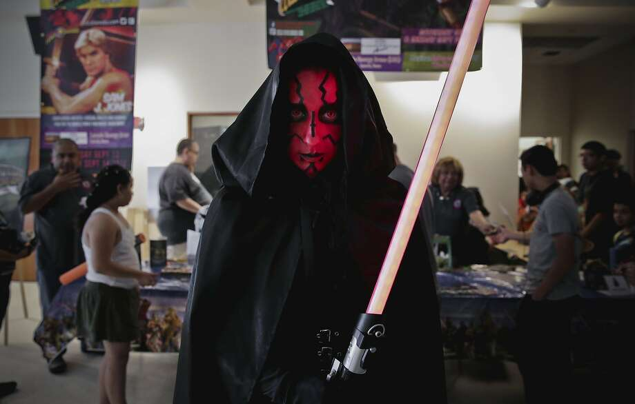 Veronica Kadrich poses for a photograph in her Darth Maul Star Wars cosplay, Sunday afternoon, at the Laredo Public Library during the Star Wars Day: May the Fourth Be With You event. Photo: Victor Strife