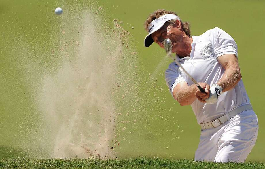 Bernhard Langer blasts out of a green side bunker on No.1 during the final round of the Insperity Championship, Sunday, May 4, 2014, at The Woodlands Country Club Tournament Course in The Woodlands. Photo: Eric Christian Smith, For The Chronicle