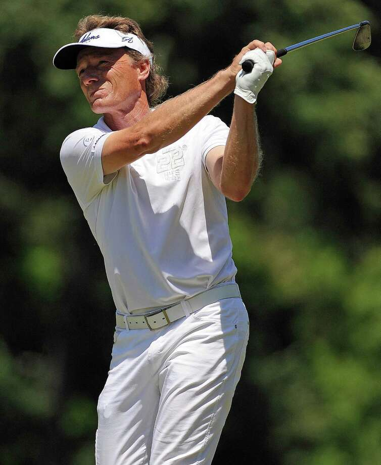 Bernhard Langer follows through on his approach shot on No. 9 during the final round of the Insperity Championship, Sunday, May 4, 2014, at The Woodlands Country Club Tournament Course in The Woodlands. Photo: Eric Christian Smith, For The Chronicle