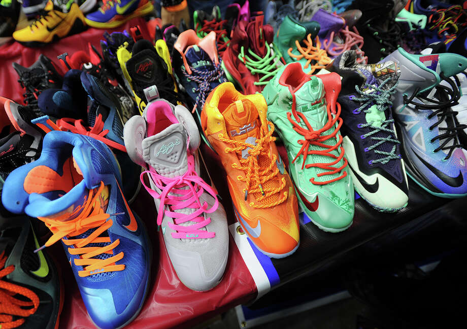 Rows of colorful sneakers for sale at the inaugural Connecticut Sneaker Show at the Webster Bank Arena in Bridgeport, Conn. on Sunday, May 4, 2014. Photo: Brian A. Pounds / Connecticut Post