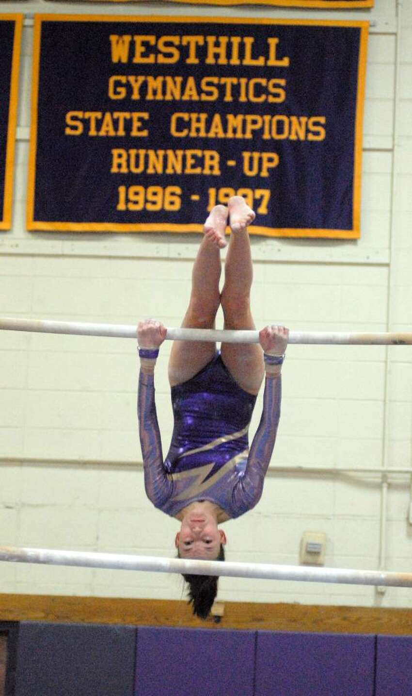 Lizzie Hart from Westhill competes at the FCIAC Gymnastics Championships at Westhill High School on Friday February 12, 2010.